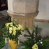 The font and flower decorations. The font is made of stone and was lead lined.