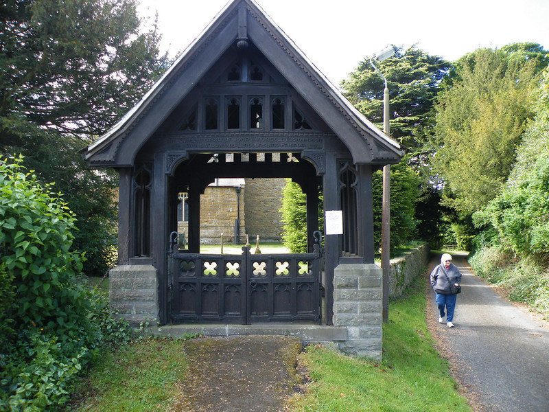 The church has a Lych Gate. The word lych survived into modern English from the Old English or Saxon word for corpse, mostly as an adjective in particular phrases or names, such as lych bell, the hand-bell rung before a corpse; lych way, the path along which a corpse was carried to burial. Tradition has it that the pall bearers waited here with the coffin, under cover, for the priest to arrive and lead them into the church for the funeral service. This gate is particularly nice.