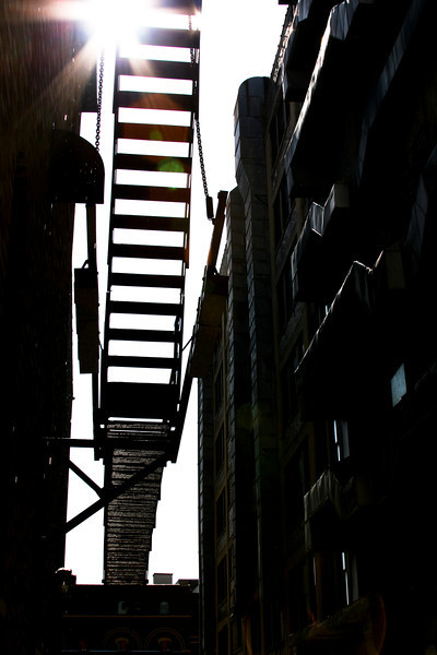Grunge stairway in a narrow alley.