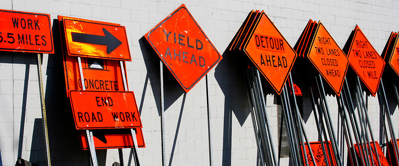 Construction signs in bold color.