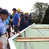 Habitat for Humanity, YouthBuild trainees, CTI, future homeowners, and volunteers prepare to raise a second floor gable of a 2-family house being built on Adams Street. (SUN/Julia Malakie)