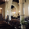 Upon entry to the church, the view is quite beautiful, gothic pillars and rich dark wood pews. The organ on the left is an 1869 Nicholson organ of historic importance. It was restored in 1999.