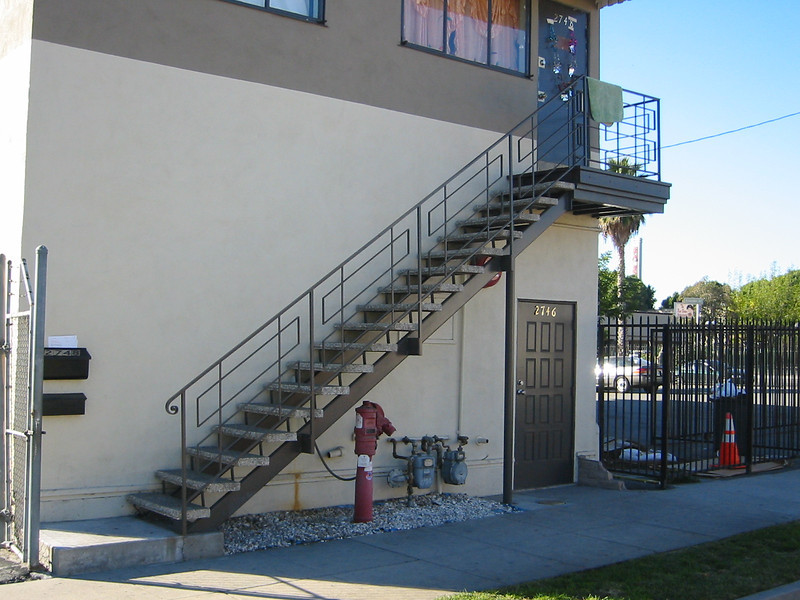 Exterior staircase and stair rail - Nina St.