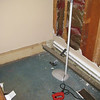 Dining room baseboard - removing sawed off fitting to temporarily plumb water to fin tube.