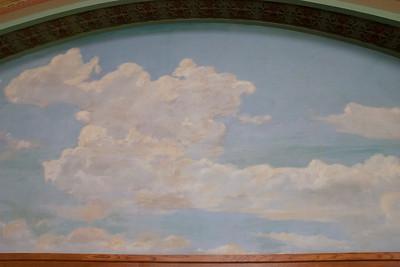 Central mural by Oskar Gross of sky and farm scenes