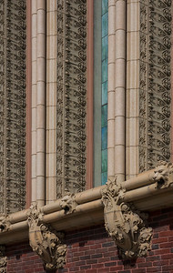 Terra cotta ornament below and between stained glass windows