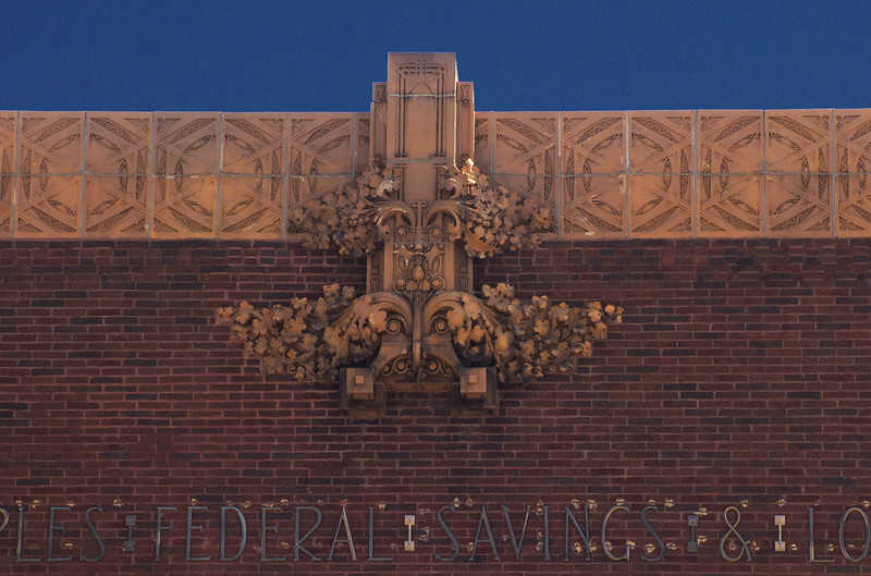 Terra cotta ornament above mosaic building title