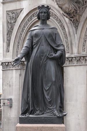 Statue to Commerce [South Parapet; West End]