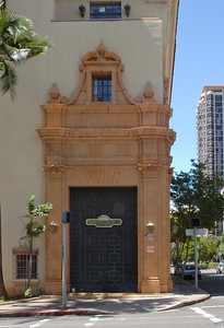 This beautiful turn-of-the-century Mediterranean style building located near the Honolulu Harbor, was built in 1931, and was the old police station.   It features cast-concrete balconies, wrought-iron balconies, metal window grilles, perforated-concrete window grilles.    Lavish and ornate details, including rococo doors & window, terra cotta scrolls, columns and Art Deco elements.  Honolulu, Hawaii