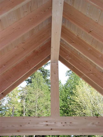 This is the roof (ceiling) of the front porch.  I can not wait to see it finished, the wood looks fabulous.  And, so fun seeing the trees this direction, a nice contrast to the water and mountains.