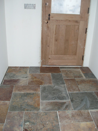 Mudroom by the back door... notice the door is a dutch door, the grout between the stones will be dark..  The wood on the door is cherry