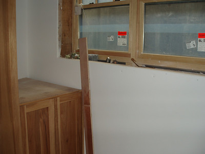 Laundry room.  Cabinets are being installed