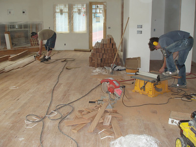 flooring into dining/living/kitchen area.  We love an informal floor plan, one room blends into the next.