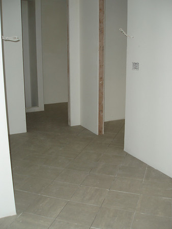 This is in our closet area.... the flooring is just layed, it still need grout.  Cabinets and doors will be added.
