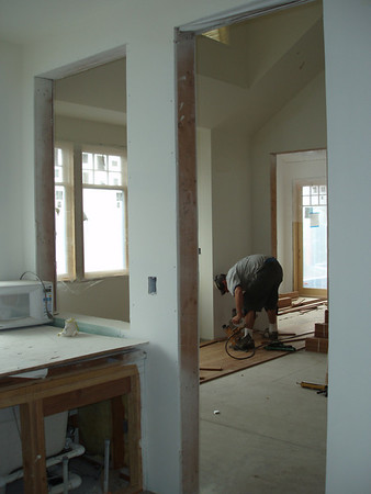 Floors are being put down.  This shot is taken from inside our bath...to the left is our soaking tub the craftsman is standing at the entry door to our bedroom, beyond him is Tim's study.