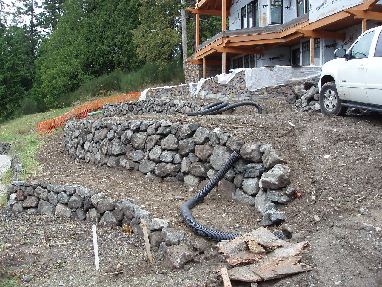 these rock walls are defining our yard.  In two years you will only see green with an accent of rock.  Plants grow crazy in the Northwest.