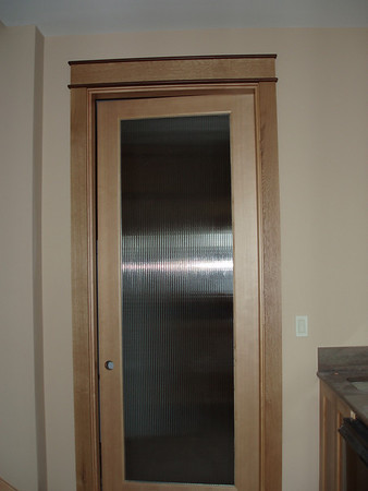 "This reed glass door belongs to the Laundry room, the counter to the right is the lower floor ""wet-bar"""