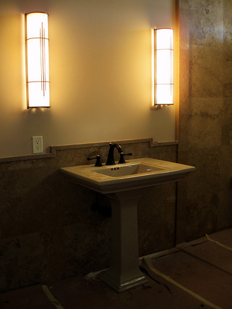 This is the sink in the guest room bath... lights are in, waiting for the mirror to be mounted.  One of our finish carpenter has a wrist injury.. so things might go a little slower than we wish.