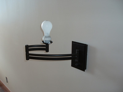 Here is a fun wall mounted lamp... We have one on each side of our bed, and on each side of the guest room bed.  The fun thing is the lower knob turns the lamp on and is also a dimmer.  We will bring the shade when we move in!