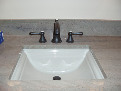 This sink is in the hall spa bath.... we are using the same faucets and handles throughout the house.  This granite will be used throughout the lower floor.  It is over-exposed in this photo, washing out the warm green colors.