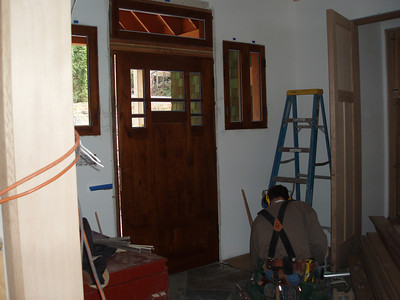 Ken is preparing the front door and windows for the new glass.