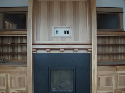 This is the fireplace and cabinetry in Tim's study.  The two upper side windows will have art glass installed.  The room behind this fireplace is the entry.