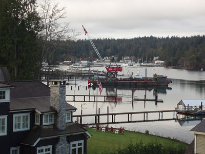 This is a picture from our patio.  Neighbors are building a new dock, hence the big crane and barge in the center of the photo.