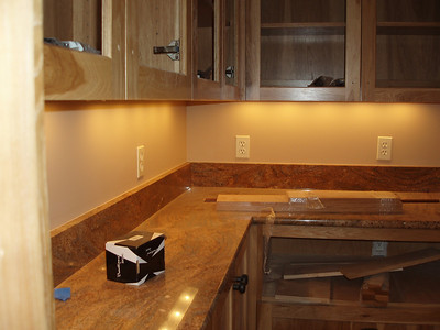 Kitchen pantry, waiting for a warming drawer, glass and knobs in the upper cabinets.