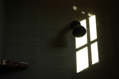 Sunshine casting shadows in our shower.