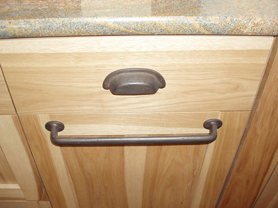 Kitchen drawer pulls.  The lower handle pulls out a 3 bin recycle center!