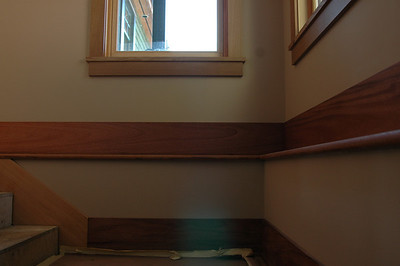 Details, I love details..this is the stair case from the lower floor, with just 3 steps up(to the left) of the main floor. The windows you see are in the stair well; each has a great view, come and see for yourself!