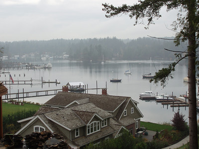 view from our north patio. Don and Barbara live in the waterfront house below, the path on the right leads to our community dock.