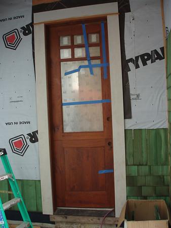 Ah, back door, dutch door, barb-e-cue door....perfect, what more could you want???  Just get rid of that typar!