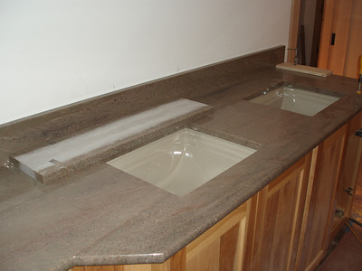 """This is the first glimpse of the """"spa"""" bath.  The sinks are in; waiting for faucets and connecting drains."""