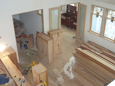 Birds eye of dining, front edge of kitchen, a bit of entry and the doors into Tim's office.