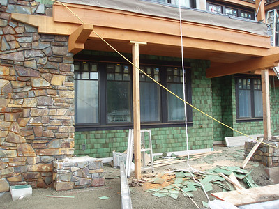 Lower back patio, we love the stone walls, the great beams and now the fun shingles.