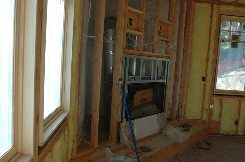 This is shot of our living room from the door that goes out onto the deck.  I will be able to look at the fireplace and the large screen TV from my cook-top in the kitchen.  We are planning to have this fireplace covered with Henry's artist stone work.