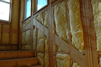 Here is a great example of framing, insulation and windows.   The wide boards are backing for the stair hand rails.  Makes me happy to see these, as I often swing down a set of stairs using my arms a lot more than my legs!
