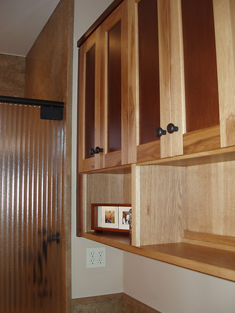 Cabinets in the guest bath are raised to allow plenty of space for wheelchair mobility.