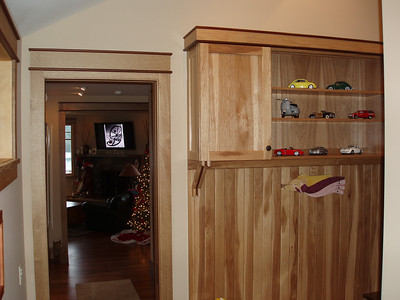 This picture was taken from the garage entrance door.  The Hickory cabinet on the right is above the shoe bench. You are looking into the stair/elevator hall and then into the living room beyond.