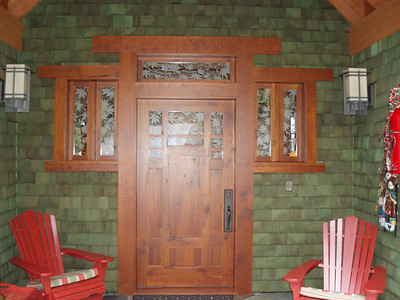 Our front door was custom made in Canada. The etched glass windows were made by a local artist.