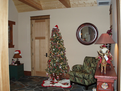 This is a view of the entry way from the dining area. This tree is filled with old fashioned ornaments we have collected for ever!