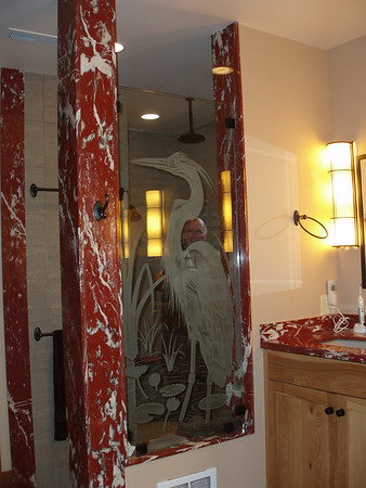Look closely and you will see Tim standing in the shower, almost hidden by the great heron.  A local artist did all of the etched and pressed glass throughout the house.