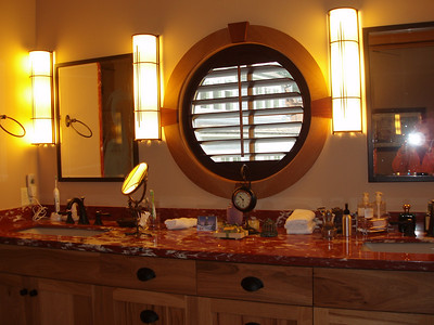 This is our master bath sink area.  The shutters on the round window give us privacy when needed.