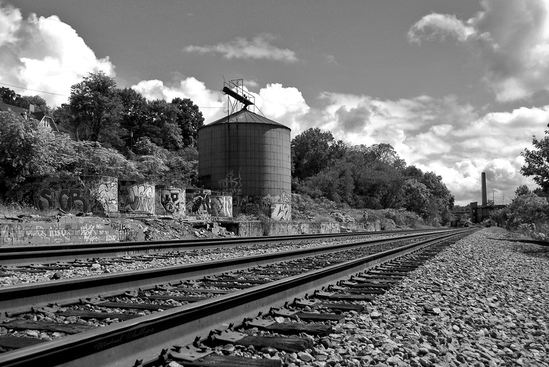 The granary tower, graffiti, and railroad tracks in River Arts District in Asheville NC.