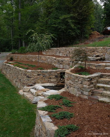 "This view of a segment of the stone retaining wall gives a sense of the horizontal scope of a stone and complexity of a retaining wall constructed at a residence near Durham, NC.    See <a href=""http://www.alechimwich.com/Landscapes/Panoramas/Panoramas/11196391_jYSK4#798929246_CUWNG"">Stone wall panorama</a> for a general description of the wall itself.  Other details of this wall may be seen in this album."