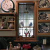 This stained glass window is installed over the counter in the kitchen shown in this album.