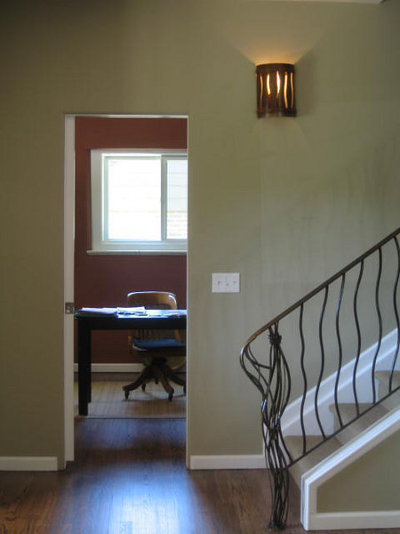Custom railing and sconce.  Natural color tones throughout the home.  1,200 s.f. addition with pop-top and whole house remodel.
