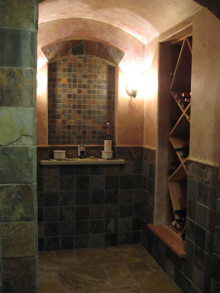 Basement wine cellar and tasting room in slate and cedar.