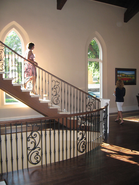 Repetition of forms.  The new stair, in plan, matches the pointed arches in the windows and hall openings in this church that was redesigned into a residence.